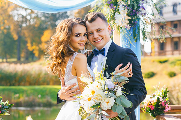 creative stylish wedding ceremony elegant curly bride and groom outdoors on the background the lake